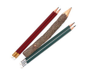 Pencils located diagonally on a white background
