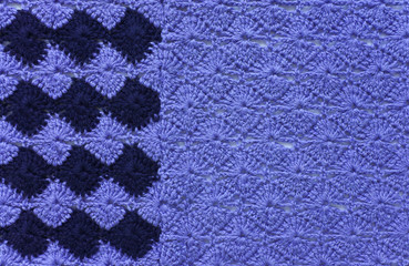 Knitted fabric of blue and dark blue yarn