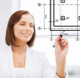 female architect drawing blueprint