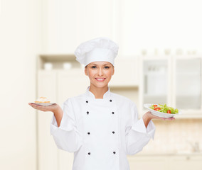 smiling female chef with salad and cake on plates