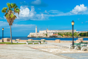 Romantic park in Havana with a view of the castle of El Morro