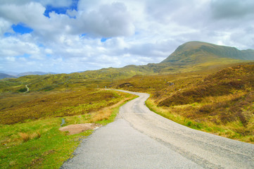 Highlands of Scotland narrow road landscape, Uk