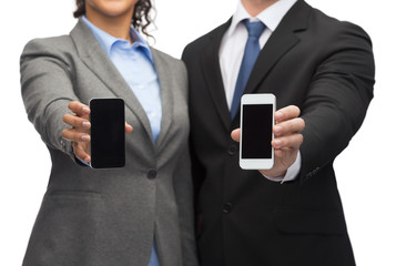 businessman and businesswoman with smartphones