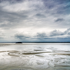 Low tide in Mont Saint Michel Bay. Normandy, France.