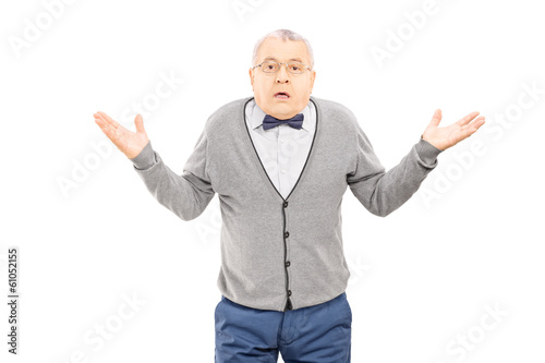 Confused senior man gesturing with hands