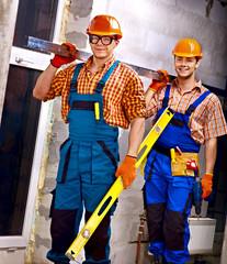 Men in builder uniform.