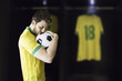 Brazilian soccer player prepares for the match kissing the ball