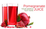 Ripe pomegranate and glasses of juice isolated on white
