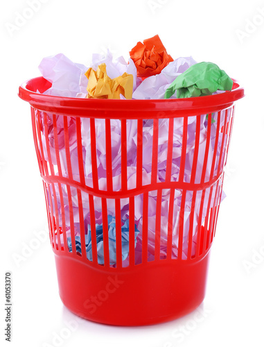 Full garbage bin, isolated on white