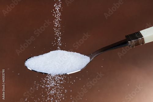 Sugar on brown background
