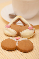 White cup bikini underwear gingerbread cake cookie on bamboo mat