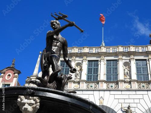 Leinwanddruck Bild Neptune Fountain and Artus Court in Gdansk Poland