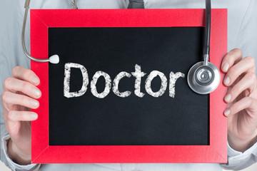 Doctor word on blackboard in doctor hands