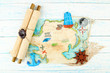 Treasure map with sea accessories, on wooden background