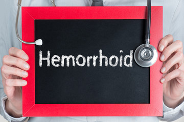 Doctor shows information on blackboard: hemorrhoid