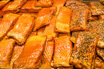Close-up of smoked salmon for sale at a fish market.