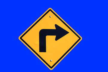turn right yellow road sign on blue  background