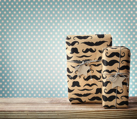 Mustache pattered gift boxes with star shaped tags