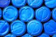 Blue plastic barrels containing chemicals