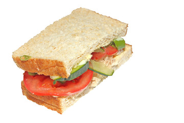 Healthy tuna and salad sandwich half isolated