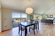 Elegant dining area with walkout deck