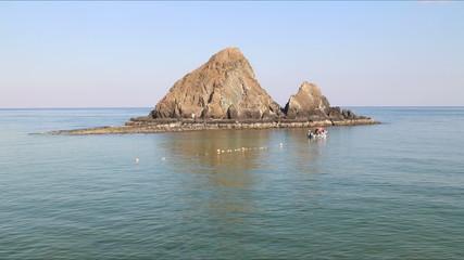mountain in the water on the hotel beach near dubai