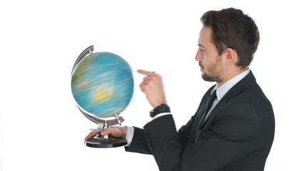 Businessman spinning a globe