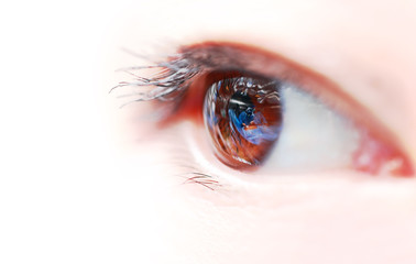 Woman's eyes with the reflection of the operating room. Medical