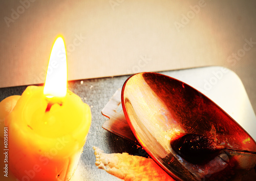Candle, a spoon with narcotic. Stylized photo.