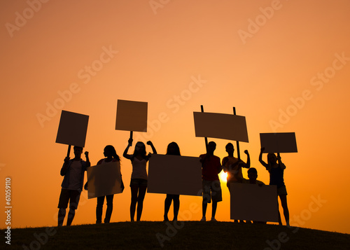People Silhouette With Sign
