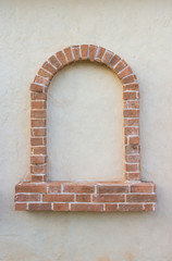 Brick window as a frame, isolated on wall