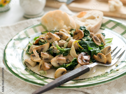 Spinach and mushroom salad with cheese, selective focus