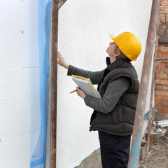 Female inspector at construction site examine works