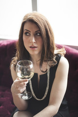 Beautiful Woman in Black Dress  Drinking White Wine