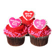 Chocolate cupcakes with red hearts on the tops, isolated