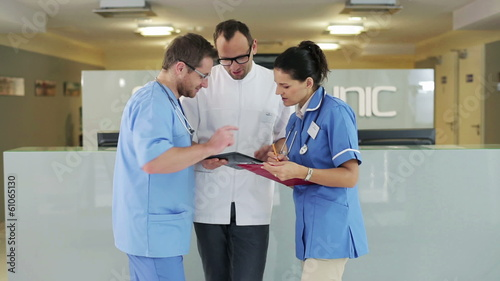 Group of medical workers consulting something in hospital