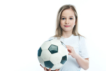 small and beautiful girl with a soccer ball