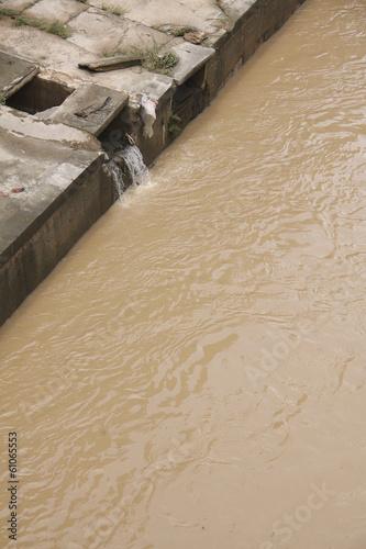 Fotobehang Kanaal Eco disaster, polluting the river.