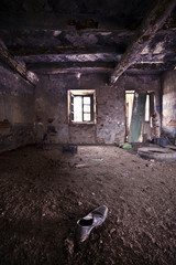Abandoned room with old shoe