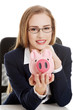 Beautiful caucasian business woman is sitting with piggy bank.