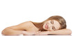 Beautiful caucasian naked woman lying on a table.