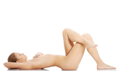 Beautiful caucasian naked woman lying down.