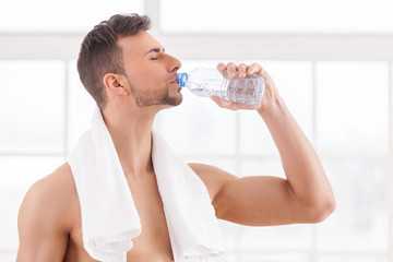 Drinking water after workout.