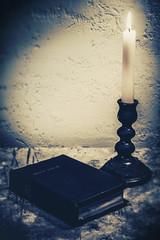 Spiritual abstract still life with Holy Bible on the desk and bu