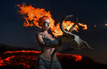 Shaman. Body painted girl with cow's skull on fiery background