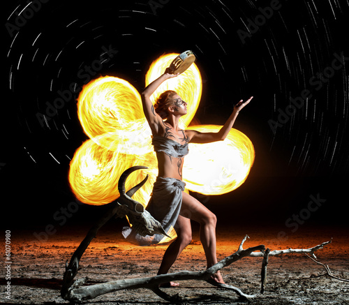 Shaman. Body painted girl dancing with the flame