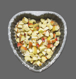 Chopped apples with sugar and, baking dish, Heart , isolated