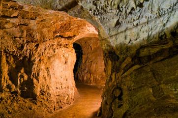 Adventure through illuminated maze of underground cave corridors