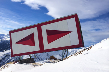 Red navigation sign in the Alps