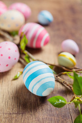 Colorful Easter eggs and branch tree with spring buds